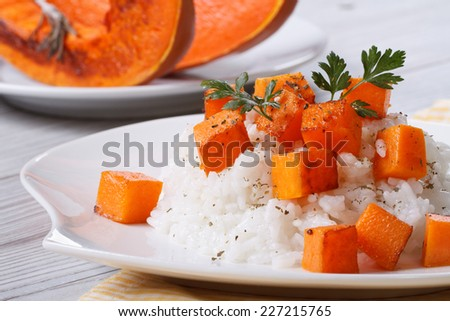 Risotto with pumpkin close-up on a plate. horizontal