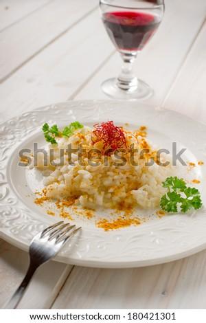 risotto with saffron pistil - stock photo
