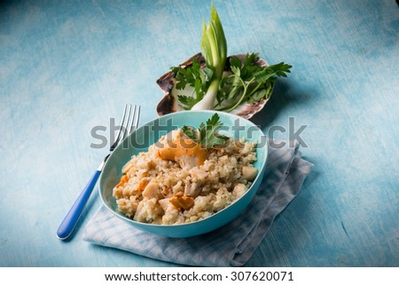 risotto with scallop - stock photo