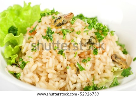 risotto with seafood isolated on a white - stock photo