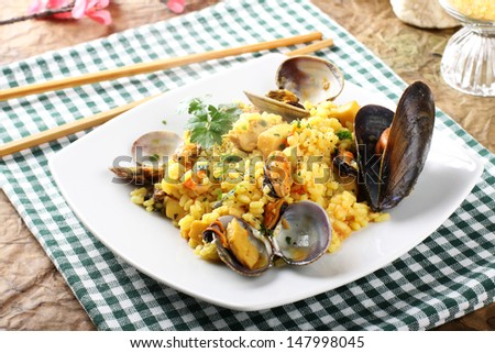Risotto with seafood on complex background - stock photo