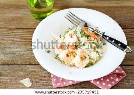 Risotto with shrimp and dill on white plate, delicious food - stock photo