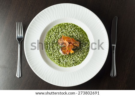 Risotto with spinach and scallop.Cutlery. Top view. - stock photo