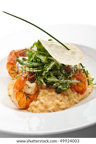 Risotto with Tiger Prawns and Rucola. Served with Parmesan Chip - stock photo
