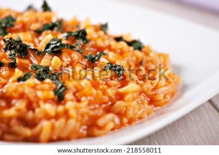 Risotto with tomatoes - stock photo