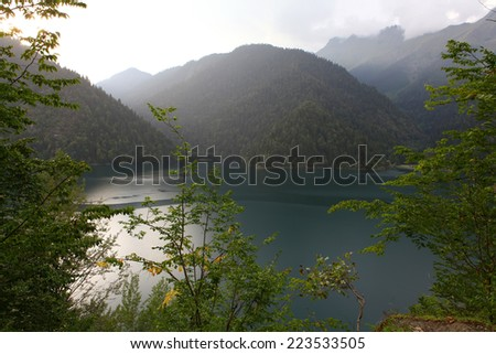 Ritsa lake, Abkhazia, summer evening after rain - stock photo
