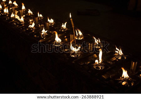 Ritual candles in Shwedagon Pagoda - stock photo
