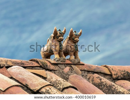 Ritual figurines of bulls on the roof in the village Raqchi. Temple of Viracocha at Chacha - Peru, South America - stock photo