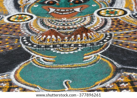Ritualistic art kalam/ dhulee chithram/ powder drawing in Wayanad, Kerala, India. temple art drawing, floor canvas. Traditional way to worship and propitiate gods Kaali, Ayyappan or Vettakkorumakan.