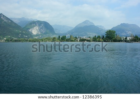 Riva del Garda city, view from Garda lake - stock photo