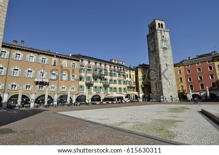 Riva del Garda, Italy - March 28, 2017: Piazza III November and Apponale tower in sunny day in early spring