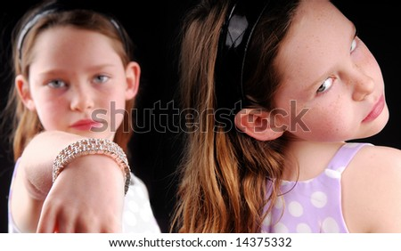 Rivalry or jealousy between girls - stock photo