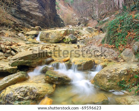 River amongst stone in canyon - stock photo