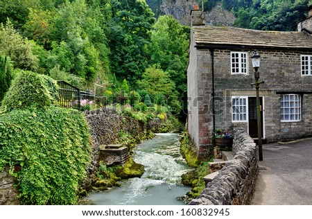 River and cottage in Castleton,Derbyshire - stock photo