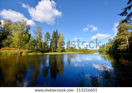 river and forest scene in Fall - stock photo