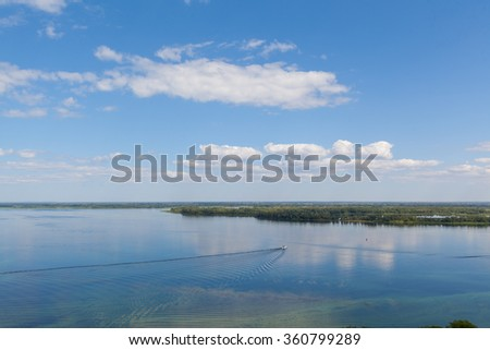river and islands under sky clouds