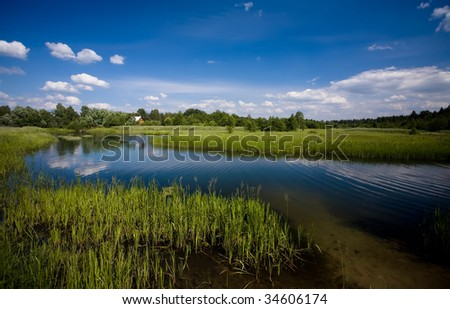 River and meadow in summer - stock photo