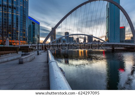 River And Modern Buildings Against Sky in Tianjin,China.
