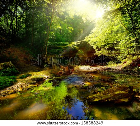 River and shaft beam of light  - stock photo
