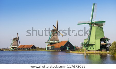 River and windmill - stock photo