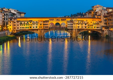 River Arno and famous bridge Ponte Vecchio at night from Ponte Santa Trinita in Florence, Tuscany, Italy