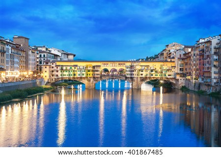 River Arno and Ponte Vecchio at night in Florence, Italy.