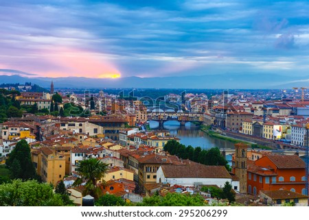 River Arno with bridge Ponte Vecchio at sunset from Piazzale Michelangelo in Florence, Tuscany, Italy - stock photo