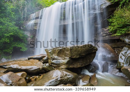 river background with small waterfalls in tropical forest.  - stock photo