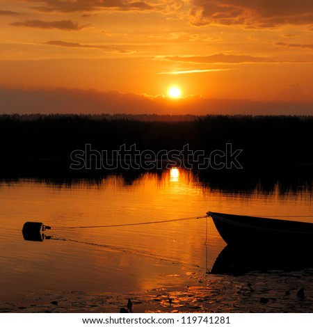 river bank sunset - stock photo