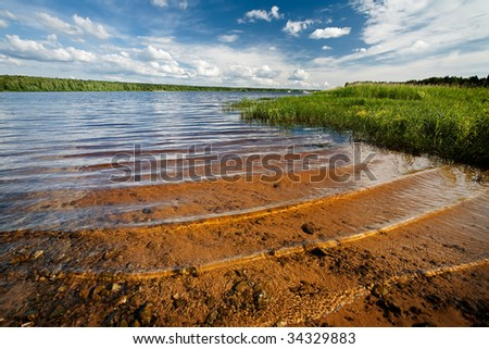 River, blue sky and clouds - stock photo