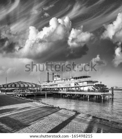 River boat with beautiful sky at sunset. - stock photo