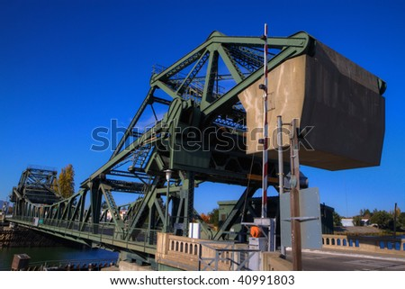 River bridge counter weight at Walnut Grove, CA in the delta of northern California done in HDR - stock photo