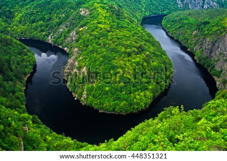 River canyon with dark water and summer green forest. Horseshoe bend, Vltava river, Czech republic. Beautiful landscape with river. Maj lookout. - stock photo