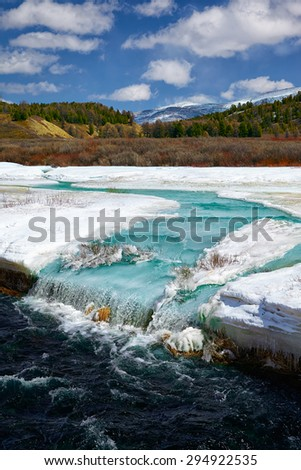 River Chibitka in Ulagan region over ice field at Spring time, Altai, Siberia, Russia