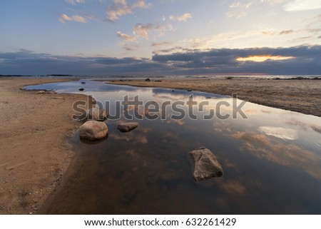 River delta on the beach at the sea coast at summer evening sunset