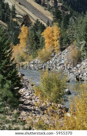 River during autumn with abandoned gold mine - stock photo