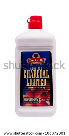 RIVER FALLS,WISCONSIN-APRIL 09, 2014: A bottle of Our Family brand Charcoal Fluid. Our Family products are distributed by Nash Finch Company of Edina,Minnesota. - stock photo