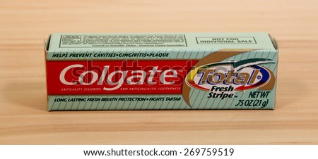 RIVER FALLS,WISCONSIN-APRIL 14,2015: A box of Colgate Total toothpaste. Colgate was first sold in Eighteen Seventy Three. - stock photo