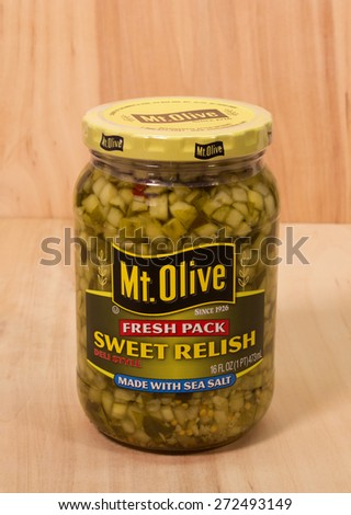 RIVER FALLS,WISCONSIN-APRIL 24, 2015: A jar of Mount Olive sweet pickle relish. Mount Olive Pickle Company is headquartered in North Carolina. - stock photo