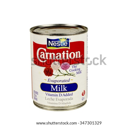 RIVER FALLS,WISCONSIN-DECEMBER 04,2015: A can of Carnation brand evaporated milk. Carnation is a product of Nestle. - stock photo