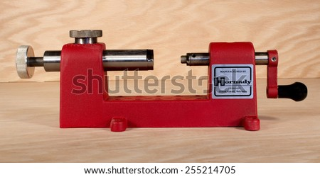 RIVER FALLS,WISCONSIN-FEBRUARY 23,2015:A Hornady metalic cartridge case trimmer. This tool is used to trim cases when reloading metallic cartridges. - stock photo