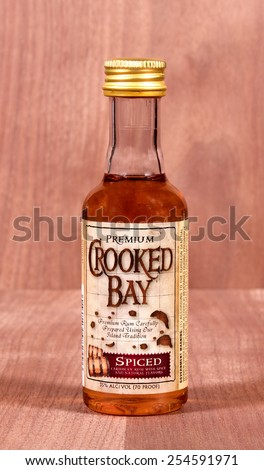 RIVER FALLS,WISCONSIN-FEBRUARY 21,2015: A sample bottle of Crooked Bay Spiced Rum. Crooked Bay Rum Company is located in Princeton,Minnesota. - stock photo