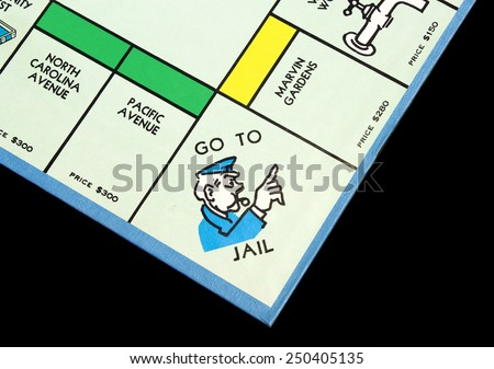 RIVER FALLS,WISCONSIN-FEBRUARY 06,2015: Corner view of a Monopoly board showing the Go To Jail space. - stock photo