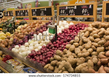 RIVER FALLS,WISCONSIN-FEBRUARY 03,2014: Produce section of a modern American supermarket.  - stock photo