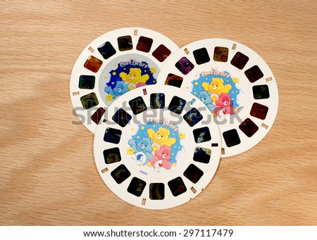 RIVER FALLS,WISCONSIN-JULY 16,2015: A group of Care Bears View-Master disks. The Care Bears were created by American Greetings Corporation in Nineteen Eighty One. - stock photo
