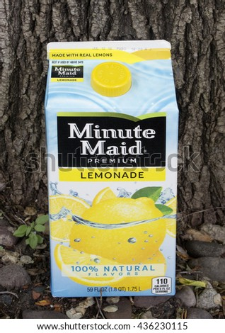 RIVER FALLS,WISCONSIN-JUNE 13,2016: A carton of Minute Maid lemonade against a bark background. - stock photo