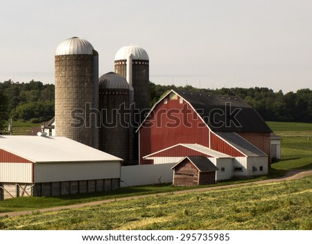 RIVER FALLS,WISCONSIN-JUNE 12,2015: A well kept barn and other structures on a small farm. - stock photo
