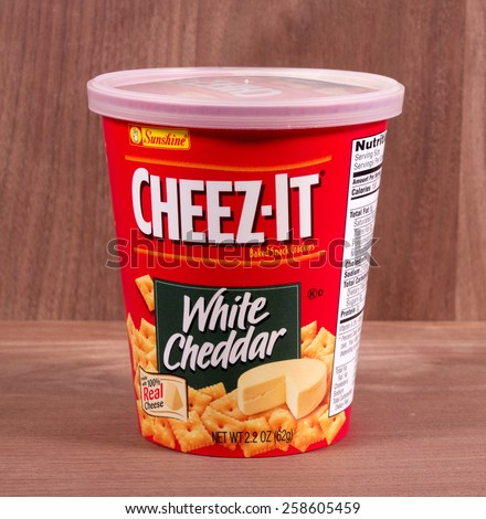 RIVER FALLS,WISCONSIN-MARCH 06,2015: A container of Cheez-It White Cheddar snack crackers. These crackers are a product of Sunshine Biscuits Incorporated. - stock photo