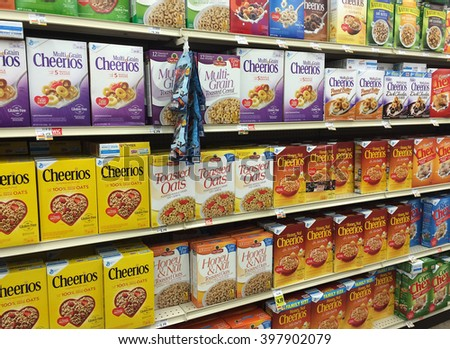 RIVER FALLS,WISCONSIN-MARCH 28,2016: Several different varieties of Cheerios cereal and other breakfast items. - stock photo