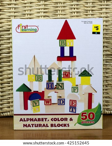 RIVER FALLS,WISCONSIN-MAY 22,2016: A box of wooden alphabet blocks for children distributed by First Learning. - stock photo